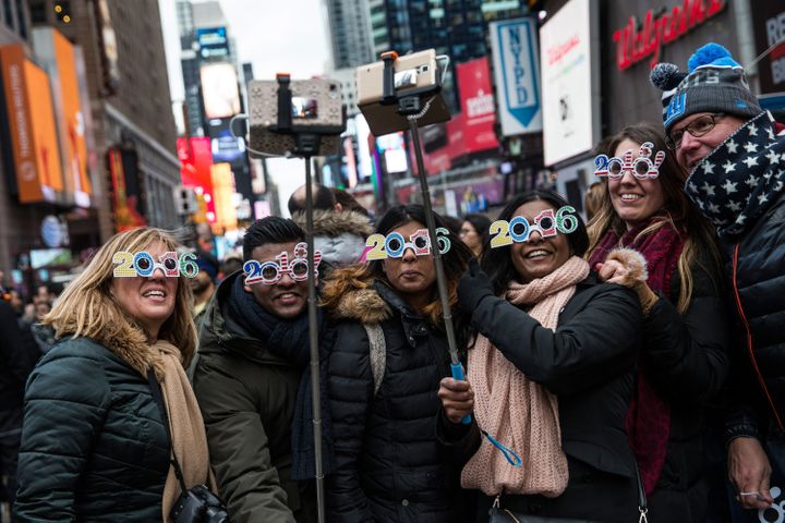 Tourists from Holland take a selfie while waiting to celebrate new years in Times Square on Thursday.