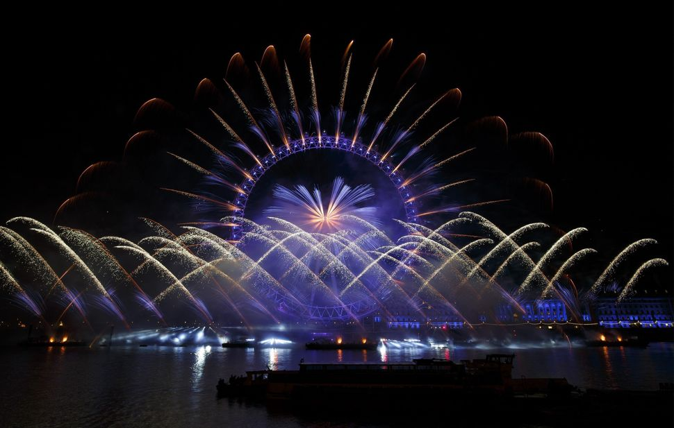 LONDON, UNITED KINGDOM - JANUARY 01: Fireworks light the sky near 'London Eye' during New Year's celebrations in London, Engl
