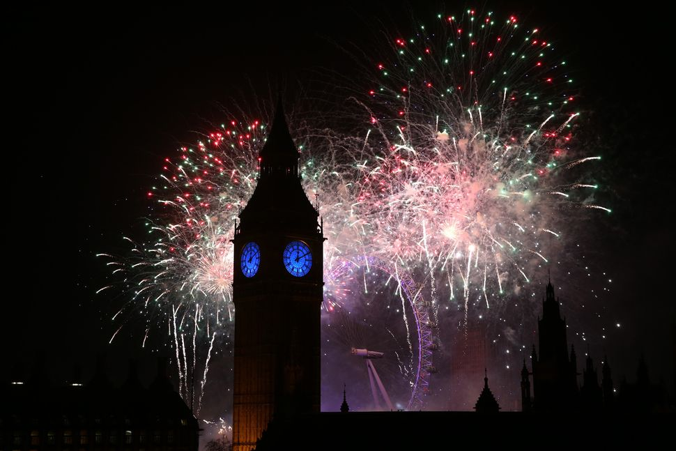 LONDON, ENGLAND - JANUARY 01:  Fireworks light up the London skyline and Big Ben just after midnight on January 01, 2016 in L