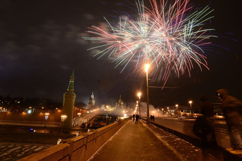 MOSCOW, RUSSIA - JANUARY 01 :  Fireworks light the sky over the Red square during the New Year's Eve celebrations on January