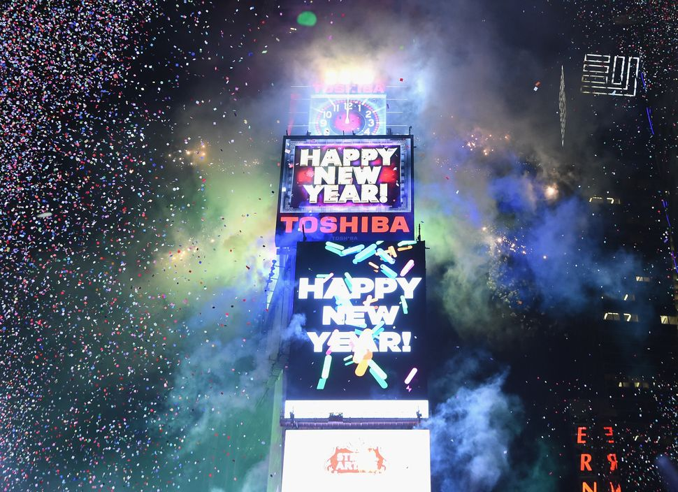 NEW YORK, NY - DECEMBER 31:  Fireworks display atop Times Square at Midnight during the Dick Clark's New Year's Rockin' Eve w