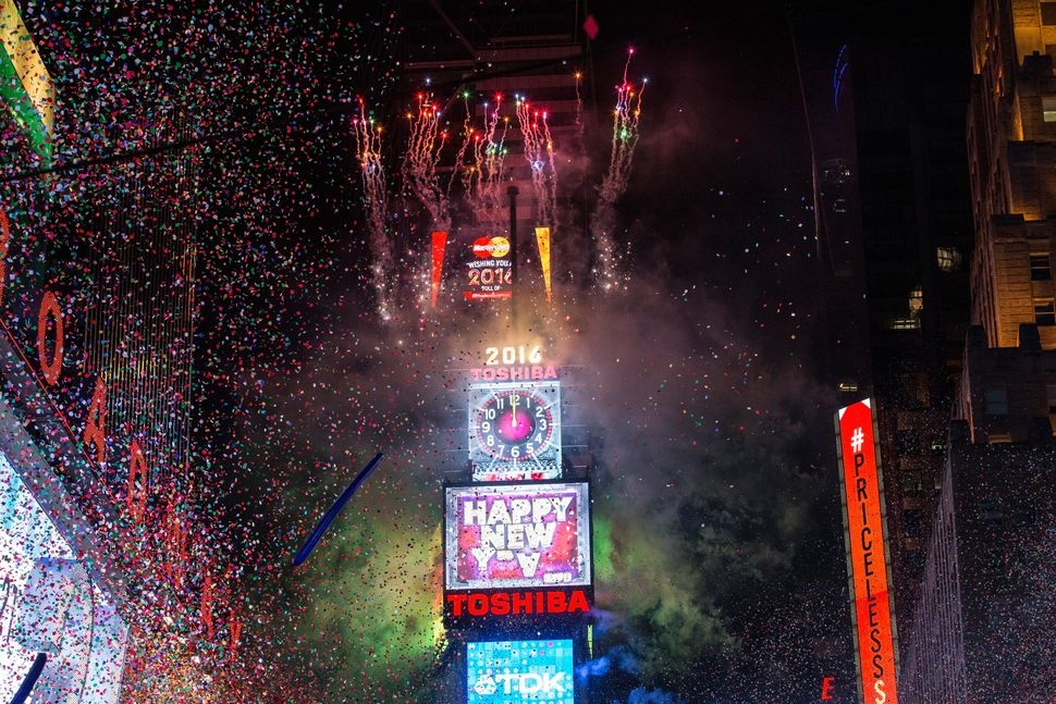 NEW YORK, NY - JANUARY 1:  Fireworks go off as the new year is rung in in Times Square on January 1, 2016 in New York City. T