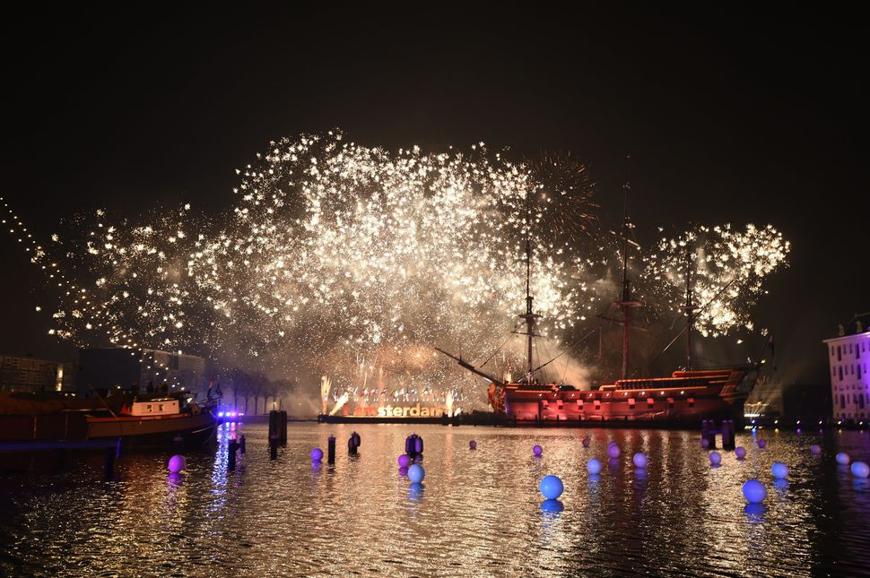 A photo taken on January 1, 2016 shows fireworks at ver the Scheepsvaartmuseum (Shipping museum) during New Year's Eve in Ams