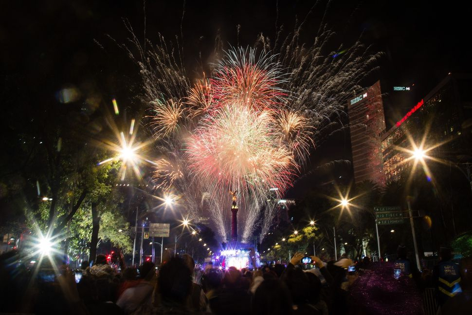 MEXICO CITY, MEXICO - DECEMBER 31: Fireworks are seen in the Angel de la Independencia (Monument to Independence) in the New
