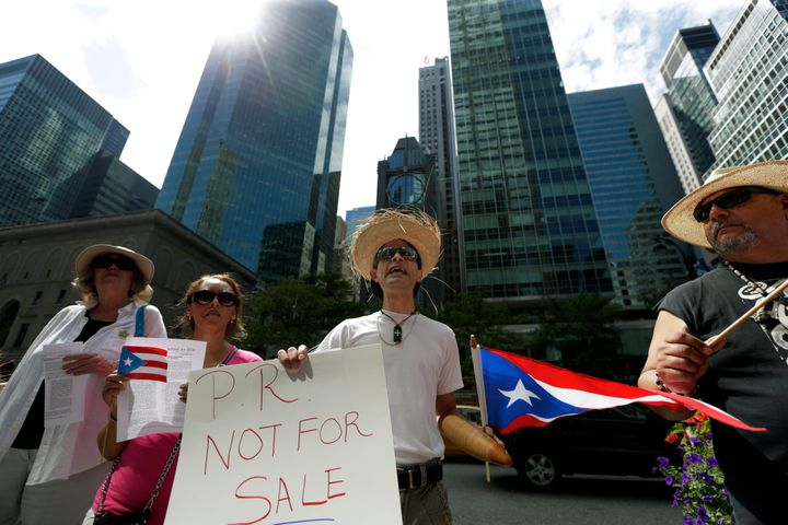 Protesters demonstrate at the Puerto Rican debt talks outside Citibank Inc. headquarters on Park Avenue in New York City