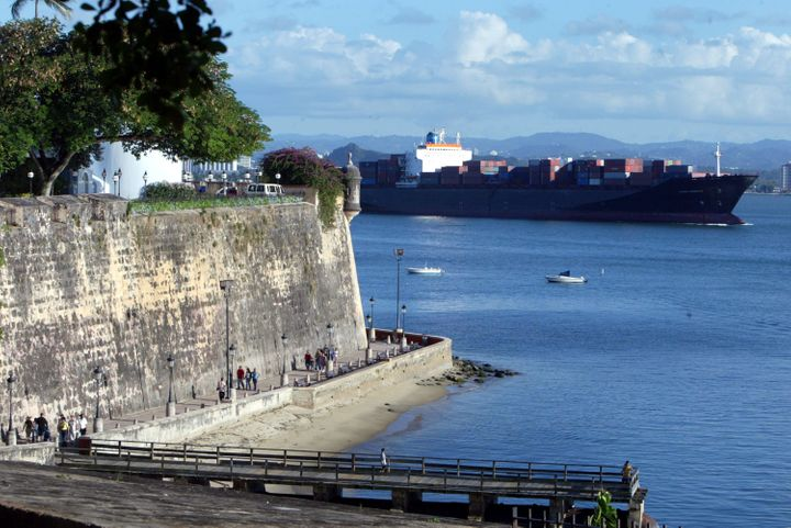 A ship passes past part of the wall that makes up La Fortaleza in Old San Juan, the original capital city of San Juan, Puerto