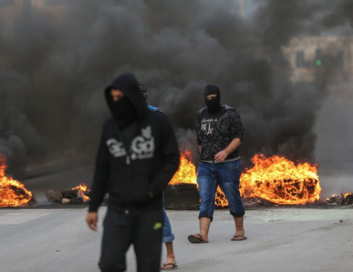Demonstrators burn tires during a protest, against the execution of prominent Shiite cleric Nimr al-Nimr by Saudi authorities