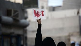 A Bahraini woman holds a placard bearing a portrait of prominent Shiite Muslim cleric Nimr al-Nimr during a protest in the village of Jidhafs, west of Manama, against his execution by Saudi authorities, on January 2, 2016. Nimr was a driving force of the protests that broke out in 2011 in the kingdom's east, an oil-rich region where the Shiite minority of an estimated two million people complains of marginalisation. AFP PHOTO / MOHAMMED AL-SHAIKH / AFP / MOHAMMED AL-SHAIKH        (Photo credit should read MOHAMMED AL-SHAIKH/AFP/Getty Images)