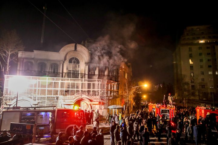 Iranian protesters set fire to the Saudi Embassy in Tehran during a demonstration against the execution of prominent Shiite M