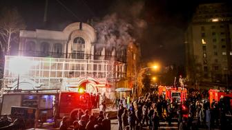 Iranian protesters set fire to the Saudi Embassy in Tehran during a demonstration against the execution of prominent Shiite Muslim cleric Nimr al-Nimr by Saudi authorities, on January 2, 2016. Nimr was a driving force of the protests that broke out in 2011 in Saudi Arabia's east, an oil-rich region where the Shiite minority of an estimated two million people complains of marginalisation.  AFP PHOTO / ATTA KENARE / AFP / ATTA KENARE        (Photo credit should read ATTA KENARE/AFP/Getty Images)
