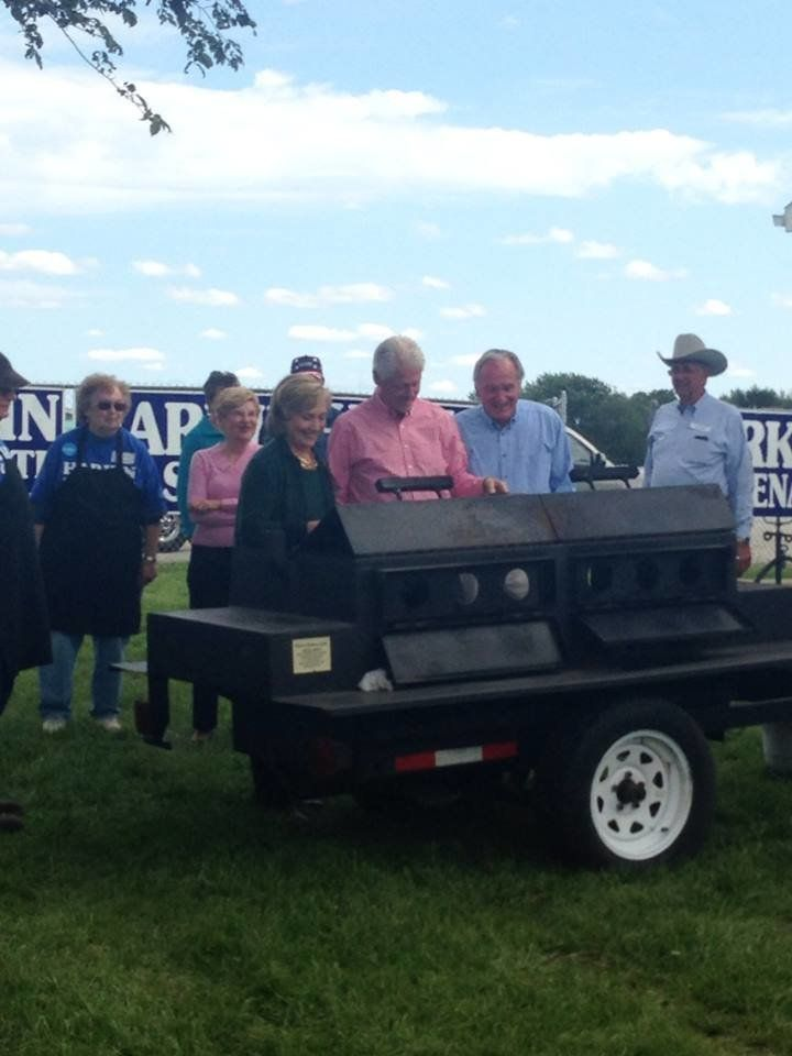 Hillary and Bill Clinton flip steaks alongside former Sen. Tom Harkin (D-Iowa) at his last Steak Fry on Sept. 15, 2014, even