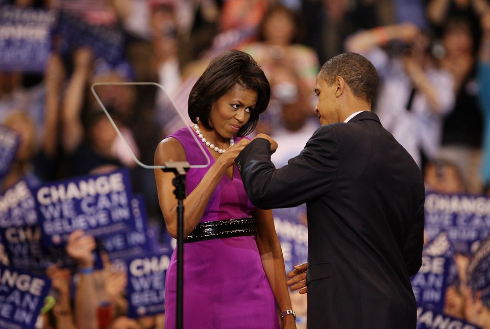 Democratic presidential candidate Sen. Barack Obama (D-IL) (R) and his wife Michelle Obama bump fists at an election night ra