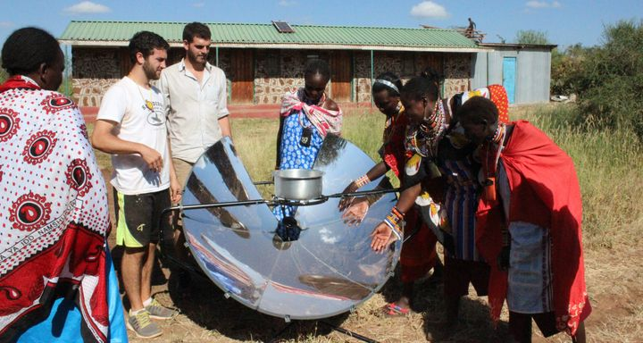 Maasai women test out cooking local cuisine on SolSource in Merrueshi, Kenya, with solar cooking trainers from the Masai Association.