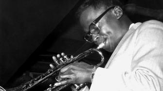 ST. LOUIS - 1958:  American jazz trumpeter Miles Davis (1926-1991) performs on stage with the Miles Davis Sextet in 1958 in St. Louis, Missouri.  (Photo by Bernie Thrasher/Metronome/Getty Images)