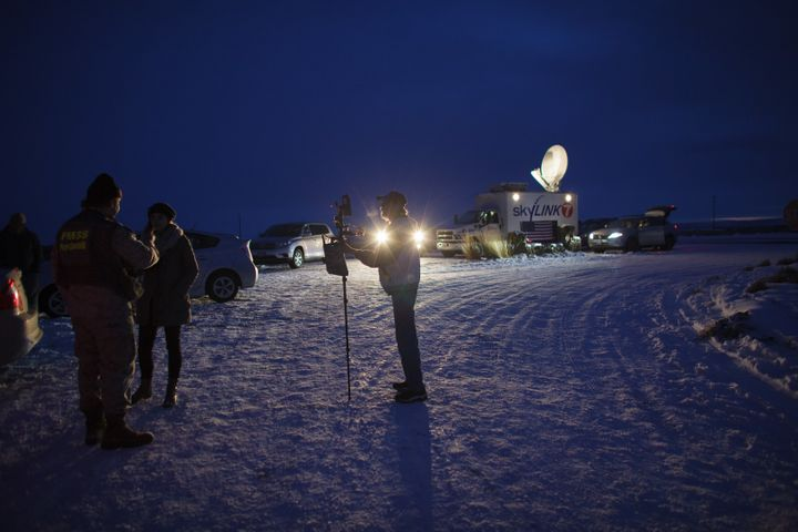 Media gather outside the entrance of the Malheur Wildlife Refuge Headquarters near Burns, Oregon, Jan. 3, 2016, where an arme