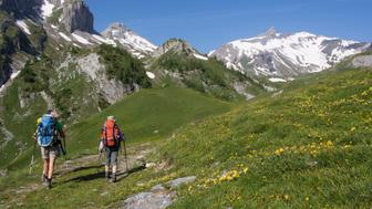 Hikers doing the circuit, Tour des Muverans, in the French speaking part of Switzerland referred to as Suisse Romande.