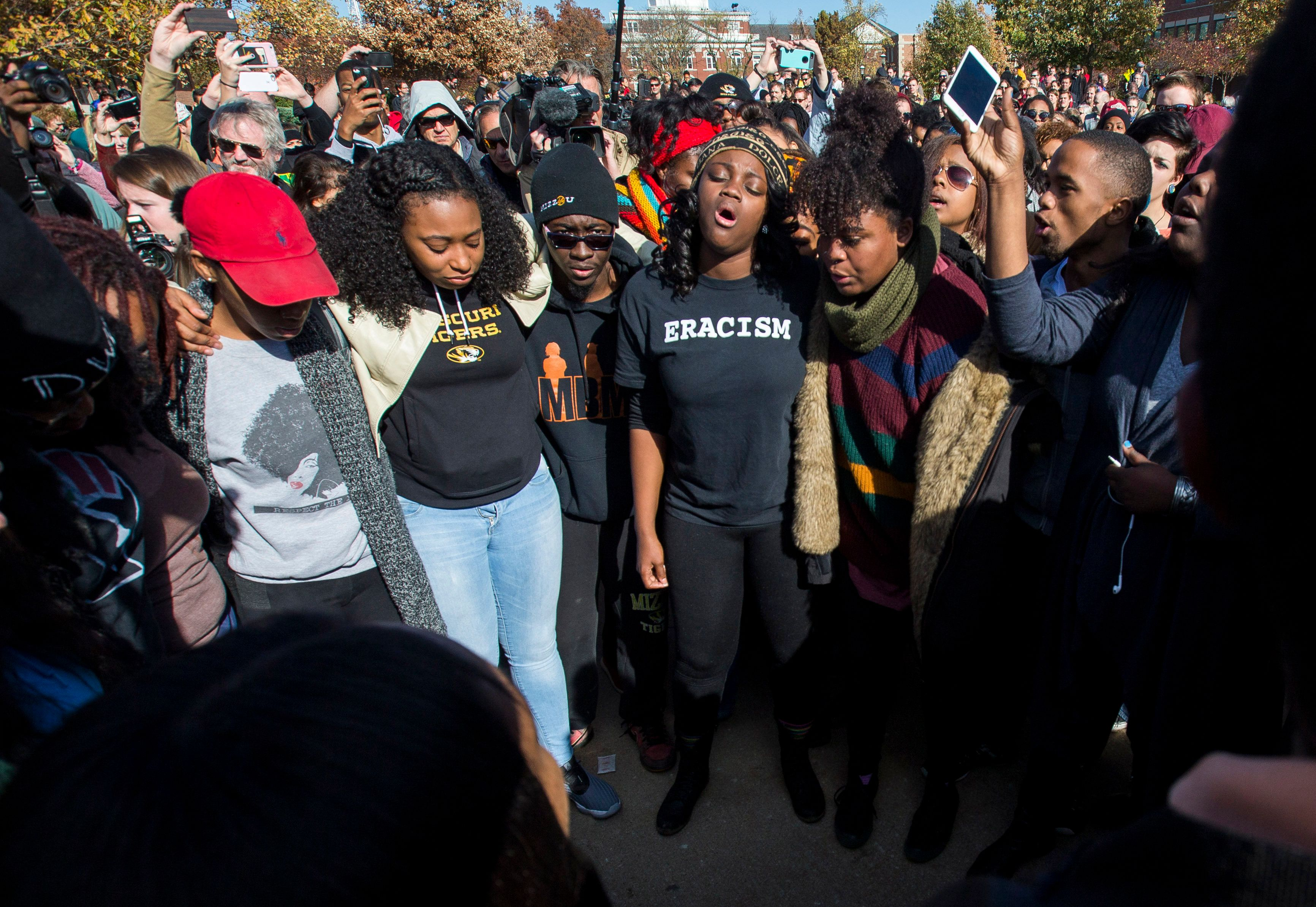 COLUMBIA, MO - NOVEMBER 9:  Members of Concerned Student 1950 celebrate after the resignation of Missouri University president Timothy M. Wolfe on the Missouri University Campus November 9, 2015 in Columbia, Missouri. Wolfe resigned after pressure from students and student athletes over his perceived insensitivity to racism on the university campus.  (Photo by Brian Davidson/Getty Images)