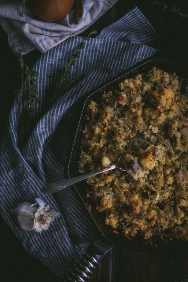 """<strong>Get the <a href=""""http://www.adventures-in-cooking.com/2014/11/cast-iron-cornbread-stuffing-with-leeks.html"""">Cast Iron"""