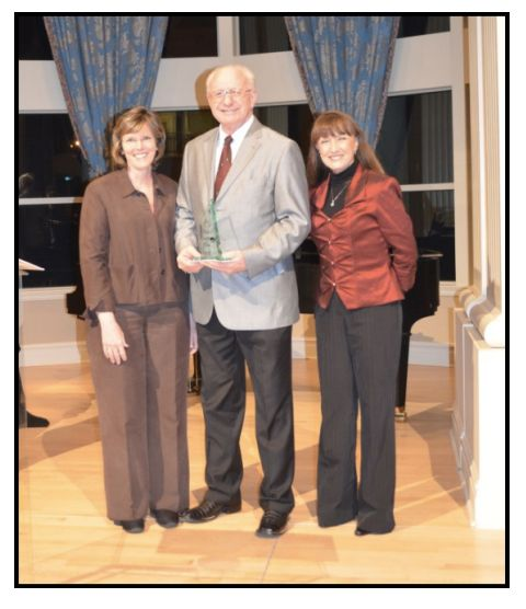 Kenneth Dewitt, in middle, holds his Employee of the Year award.