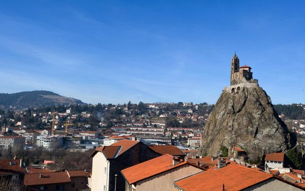 "This <a href=""http://www.atlasobscura.com/places/saint-michel-d-aiguilhe-st-michael-of-the-needle"">chapel</a> is built at the"