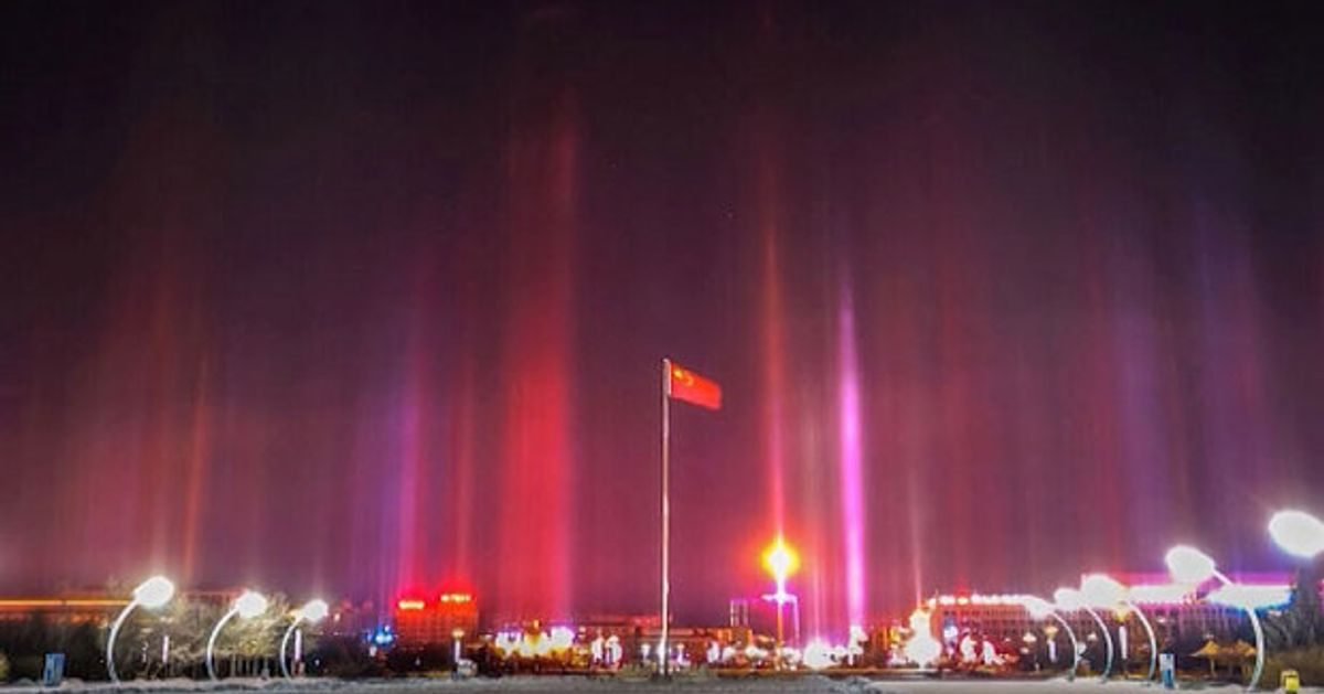Beautiful Beams Of Light Sparkle In Skies Above Chinese City