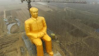 This photo taken on January 4, 2016 shows a huge statue of Chairman Mao Zedong under construction in Tongxu county in Kaifeng, central China's Henan province. The statue reportedly measures 120 feet (36.6meters) in height and is located in Zhushigang village.   CHINA OUT   AFP PHOTO / AFP / STR        (Photo credit should read STR/AFP/Getty Images)