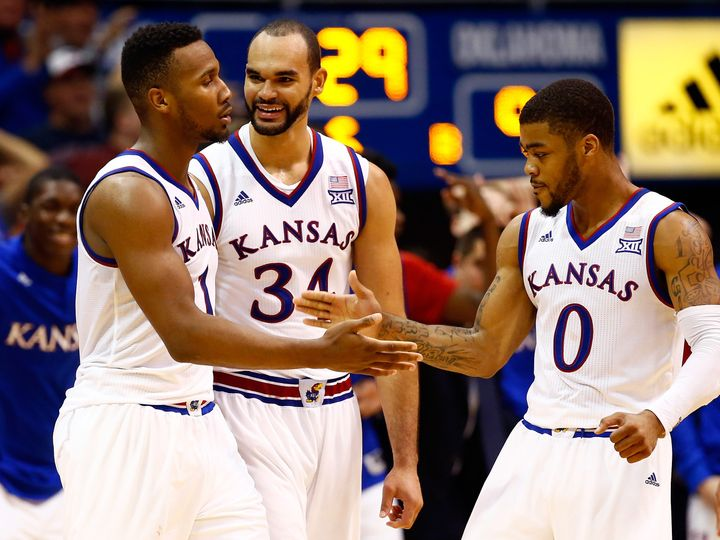 Wayne Selden Jr., Perry Ellis and Frank Mason III celebrate late in the game against Oklahoma at Allen Fieldhouse on Jan