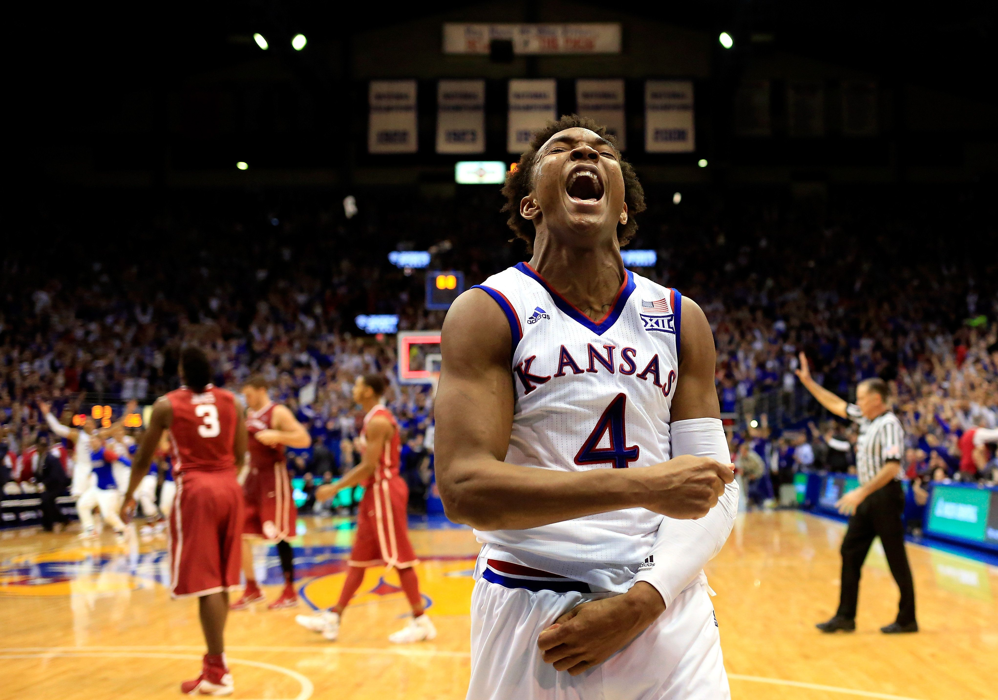LAWRENCE, KS - JANUARY 04:  Devonte' Graham #4 of the Kansas Jayhawks celebrates as the Jayhawks defeat the Oklahoma Sooners 109-106 in triple overtime to win the game at Allen Fieldhouse on January 4, 2016 in Lawrence, Kansas.  (Photo by Jamie Squire/Getty Images)
