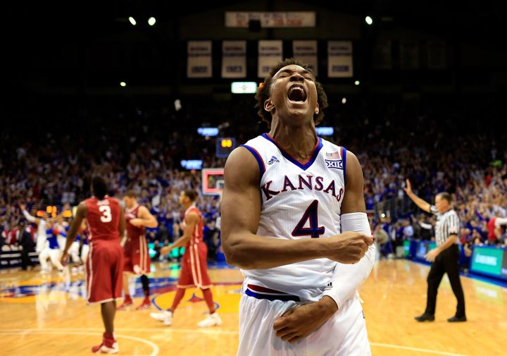 Kansas' Devonte' Graham celebrates as the Jayhawks defeat the Oklahoma Sooners, 109-106, at Allen Fieldhouse on Jan