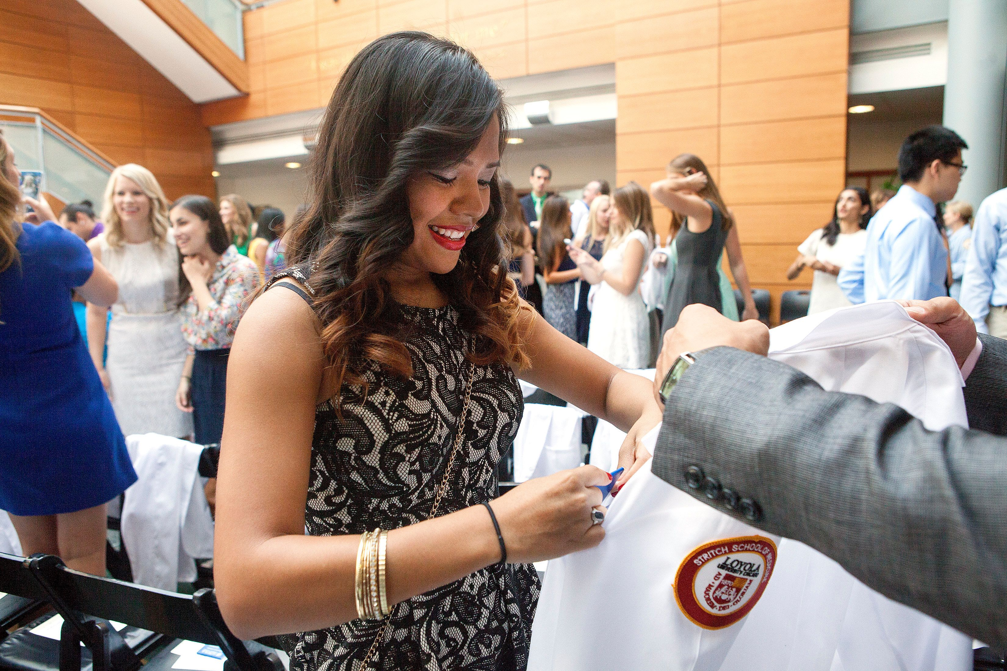 Emelin Garcia receives her white coat at a ceremony at Stritch School of Medicine at Loyola University Chicago.