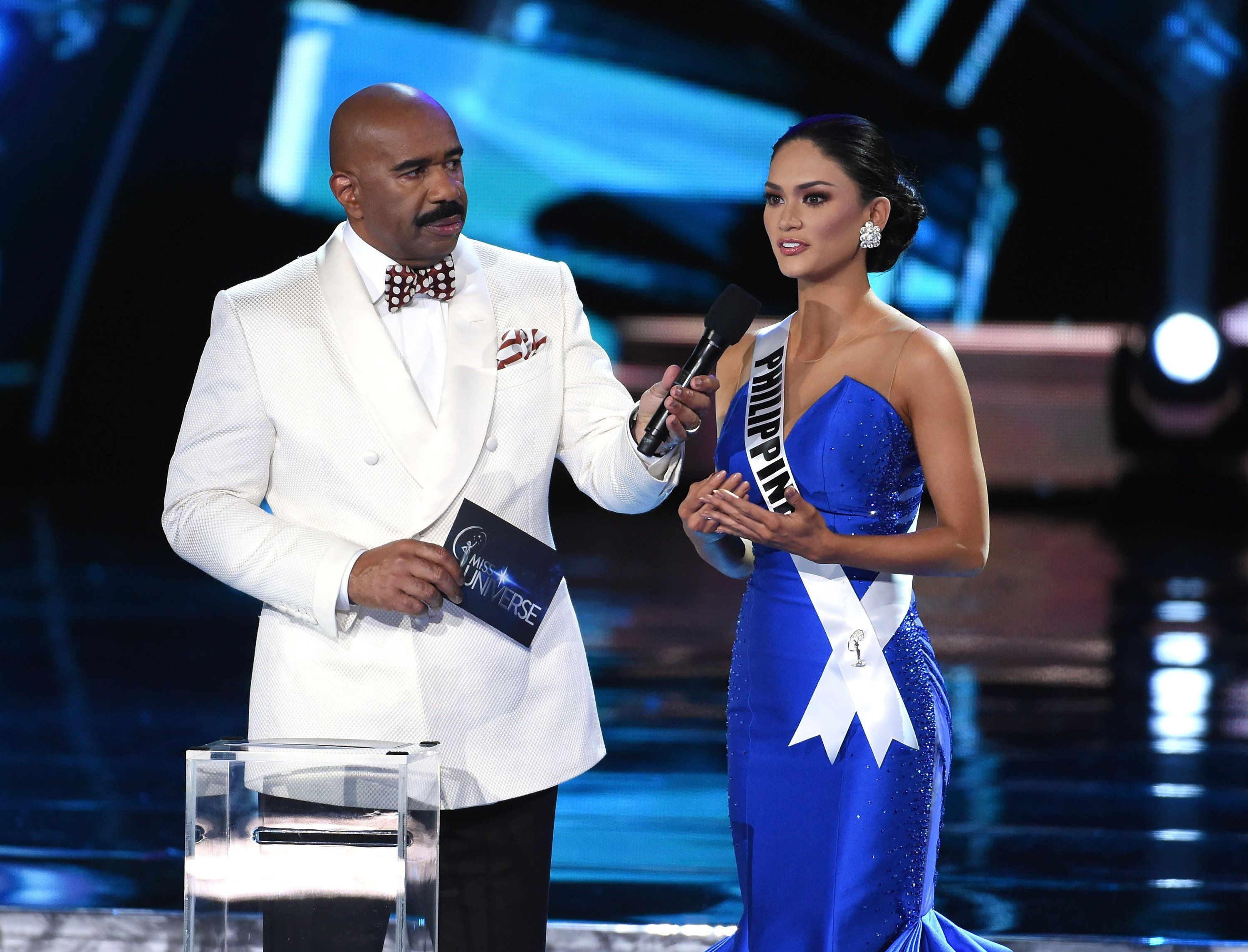 LAS VEGAS, NV - DECEMBER 20:  Host Steve Harvey (L) listens as Miss Philippines 2015, Pia Alonzo Wurtzbach, answers a question during the interview portion of the 2015 Miss Universe Pageant at The Axis at Planet Hollywood Resort & Casino on December 20, 2015 in Las Vegas, Nevada. Wurtzbach went on to be crowned the new Miss Universe.  (Photo by Ethan Miller/Getty Images)