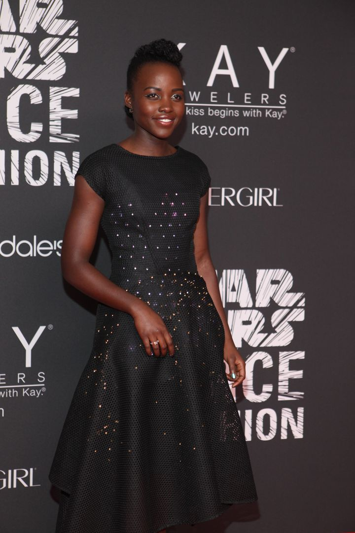 """Lupita Nyong'o wearing a Zac Posen x The Crated design on a """"Star Wars"""" premiere red carpet in 2015."""