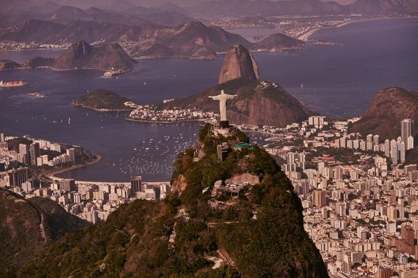 "This <a href=""http://www.britannica.com/topic/Christ-the-Redeemer"">98-foot-high</a> statue of Jesus towers&nbsp;over the city"