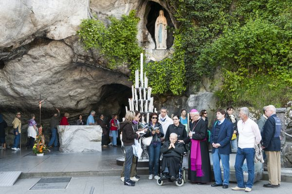 "According to <a href=""http://www.pbs.org/wgbh/sacredjourneys/content/lourdes/"">Catholic tradition</a>, the Virgin Mary appear"