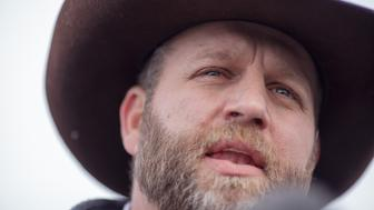 Ammon Bundy, leader of a group of armed anti-government protesters speaks to the media, at the Malheur National Wildlife Refuge near Burns, Oregon January 4, 2016. The FBI on January 4 sought a peaceful end to the occupation by armed anti-government militia members at a US federal wildlife reserve in rural Oregon, as the standoff entered its third day. The loose-knit band of farmers, ranchers and survivalists -- whose action was sparked by the jailing of two ranchers for arson -- said they would not rule out violence if authorities stormed the site, although federal officials said they hope to avoid bloodshed. AFP PHOTO / ROB KERR / AFP / ROB KERR        (Photo credit should read ROB KERR/AFP/Getty Images)