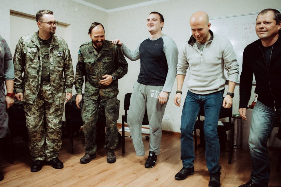 Participants at the end of a physical exercise at Wounded Warrior Ukraine's PTSD seminar.