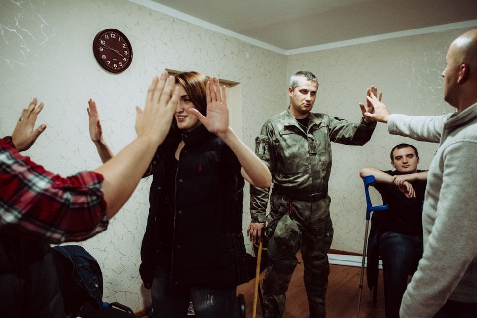 People take part in a PTSD seminar organized by the Wounded Warrior Ukraine.
