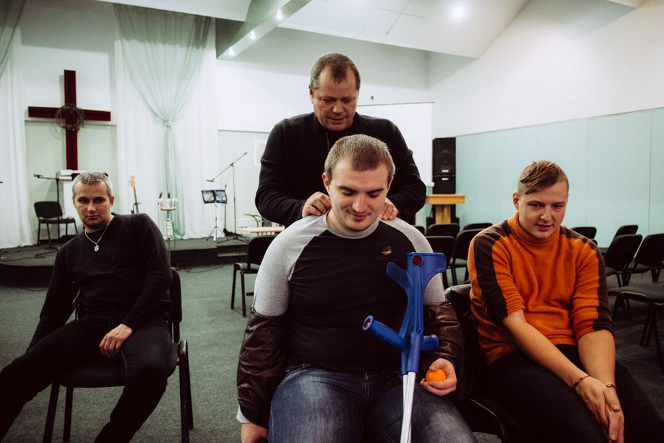 Maxim receives a massage from another participant at Wounded Warrior Ukraine's seminar for extreme psychology and P