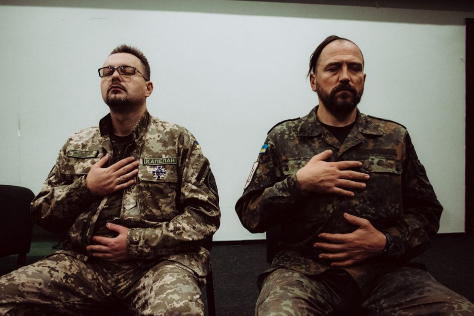 Participants take part in breathing exercises at a PTSD seminar offered by Wounded Warrior Ukraine, a...