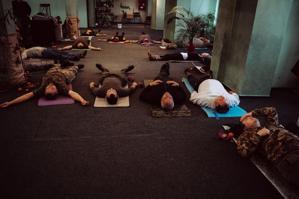Participants practice the techniques of self massage, a proven method to reduce psychological shock and PTSD, at Wounded Warr