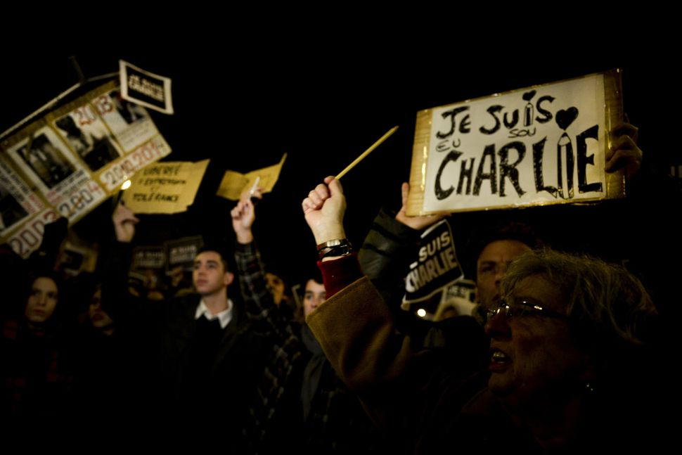 Hundreds of people gather holding pencils and posters reading 'Je Suis Charlie (I Am Charlie)'in Lisbon on Jan. 8, 2015