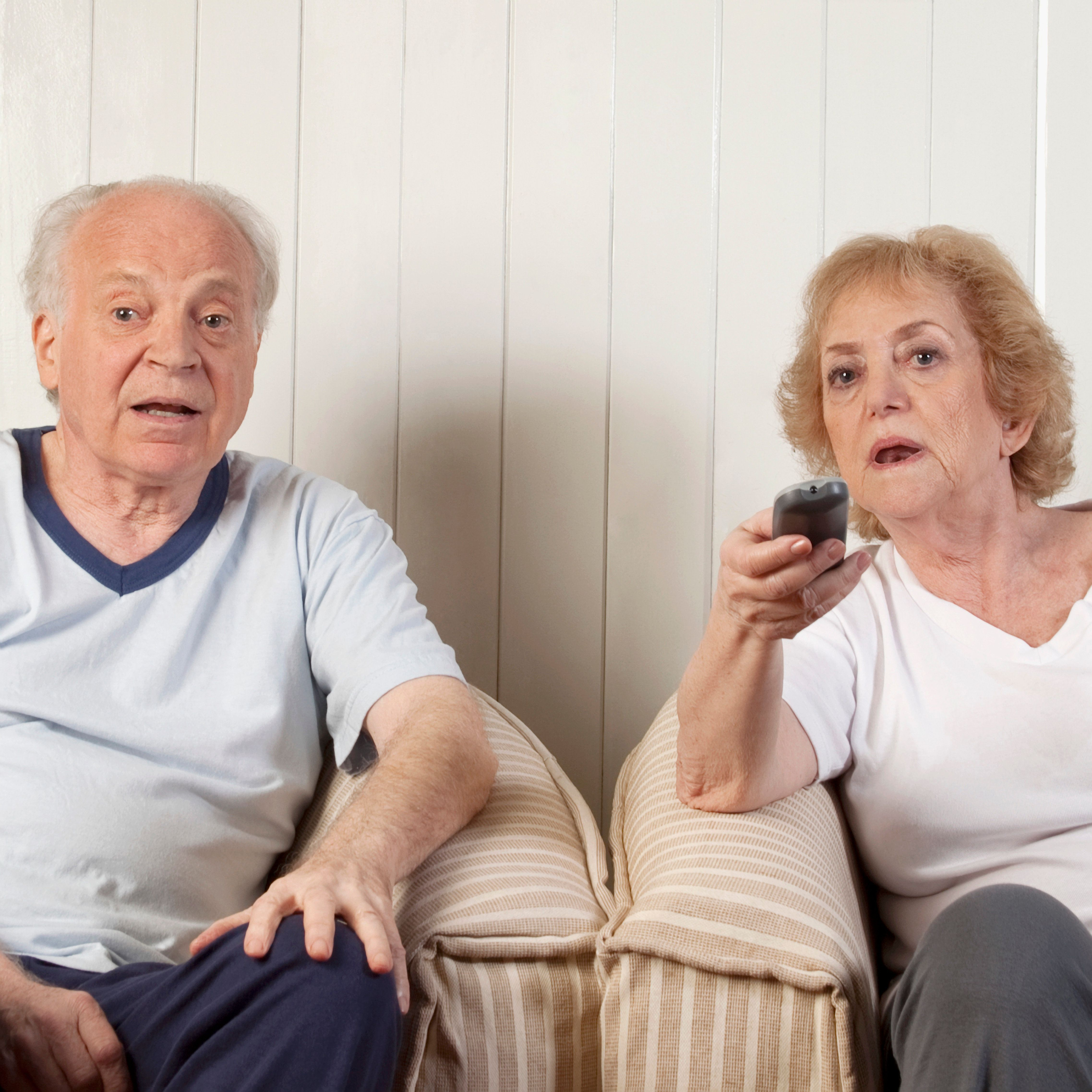 Couple watching television in the living room