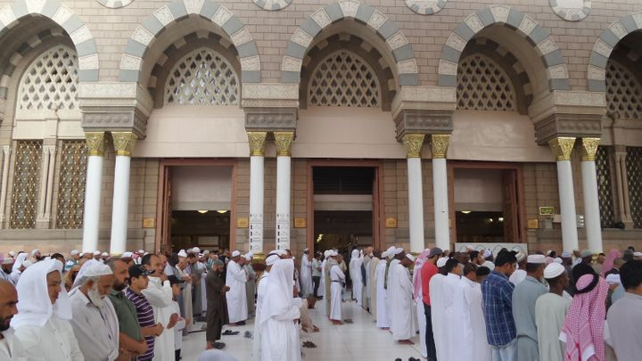 Muslim pilgrims pray at the Masjid al-Nabawi (The Prophet's Mosque), where the tomb of Prophet Mohammad is located, in Medina
