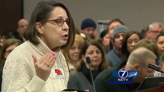 A woman speaks at an Omaha Public Schools meeting.