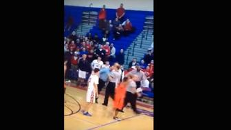 High school coach hits referee.