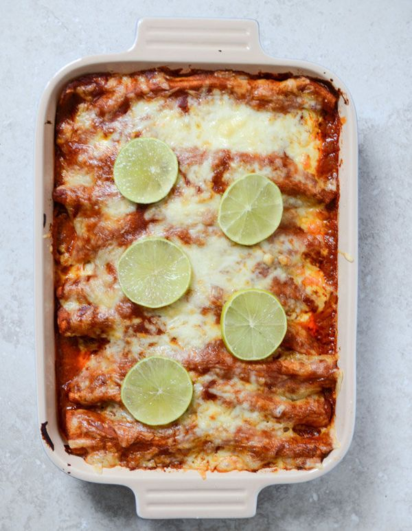 """<strong>Get the <a href=""""http://www.howsweeteats.com/2013/12/spicy-beer-braised-lime-chicken-enchiladas/"""">Spicy Beer Braised"""