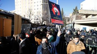 TEHRAN, IRAN - JANUARY 3: Demonstrators hold posters of Nimr Baqir al-Nimr and shout slogans during a protest rally outside the embassy of Saudi Arabia against the execution of prominent Saudi Shia cleric Nimr Baqir al-Nimr by Saudi authorities, in Tehran, Iran on January 2016. (Photo by Stringer/Anadolu Agency/Getty Images)