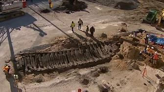 Archeologists are seen excavating a Revolutionary War-era ship beneath a hotel's construction site.