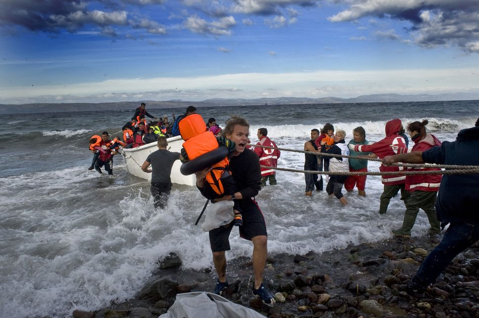 Refugee boats reach Lesbos.