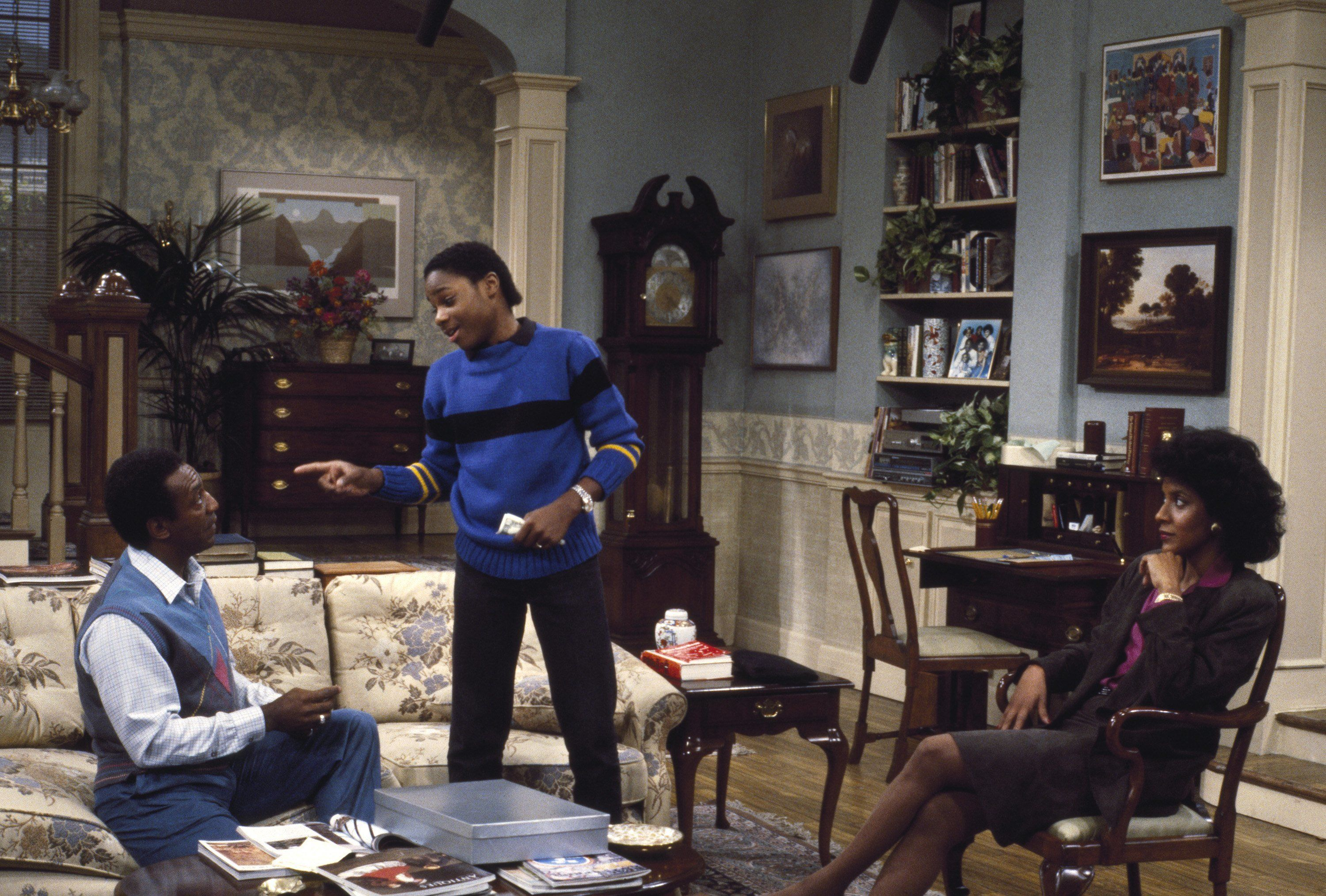THE COSBY SHOW -- Pictured: (l-r) Bill Cosby as Dr. Heathcliff 'Cliff' Huxtable, Malcolm-Jamal Warner as Theodore 'Theo' Huxtable, Phylicia Rashad as Clair Hanks Huxtable -- Photo by: R. M. Lewis Jr./NBCU Photo Bank